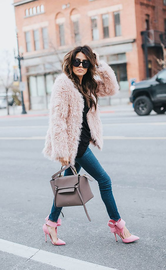 pink bow heels and a pink fuzzy coat