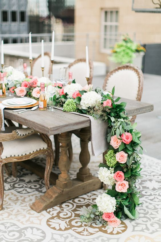 leaves, ivory hydrangeas and pink roses look lush and spring-like