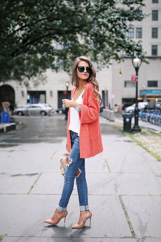 ripped blue skinnies, a white top, lace up blush shoes and a coral cardigan