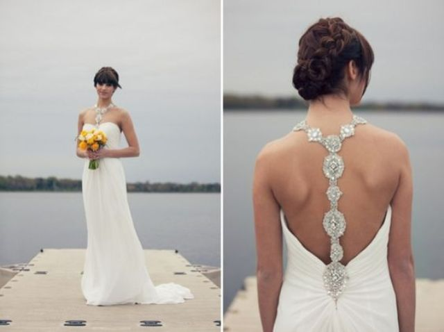 strapless wedding dress with a jeweled racerback showing up on the front as an accessory