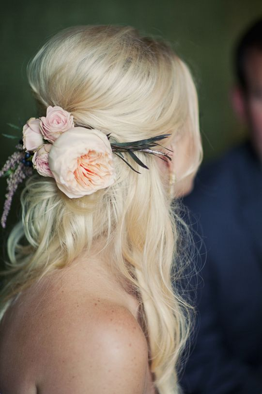 messy half updo with blush blooms