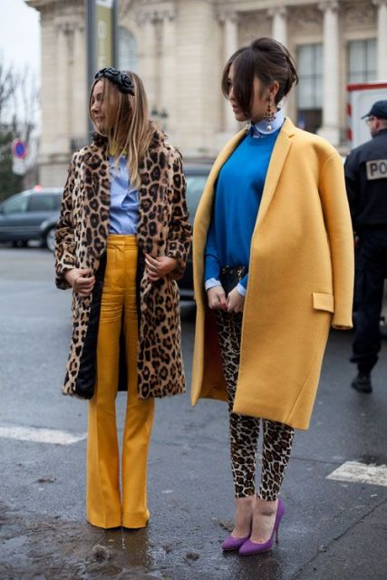 With blue shirt and leopard coat