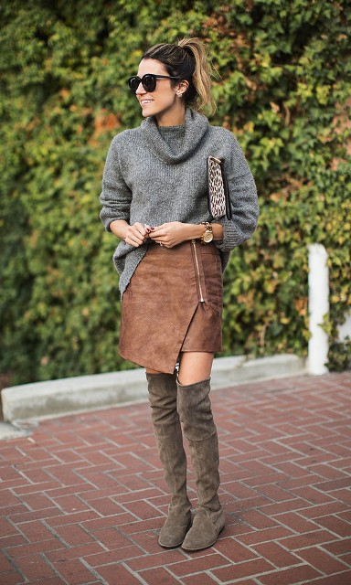With gray turtleneck, over the knee boots and leopard clutch