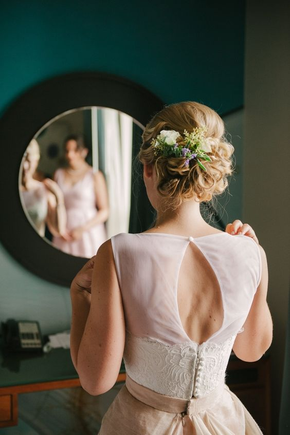 curly updo with fresh blooms and greenery