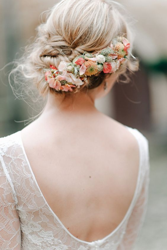 braided wedding updo with fresh flowers in it