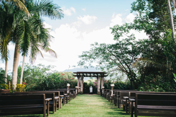 The ceremony and reception took place in a lush tropical garden