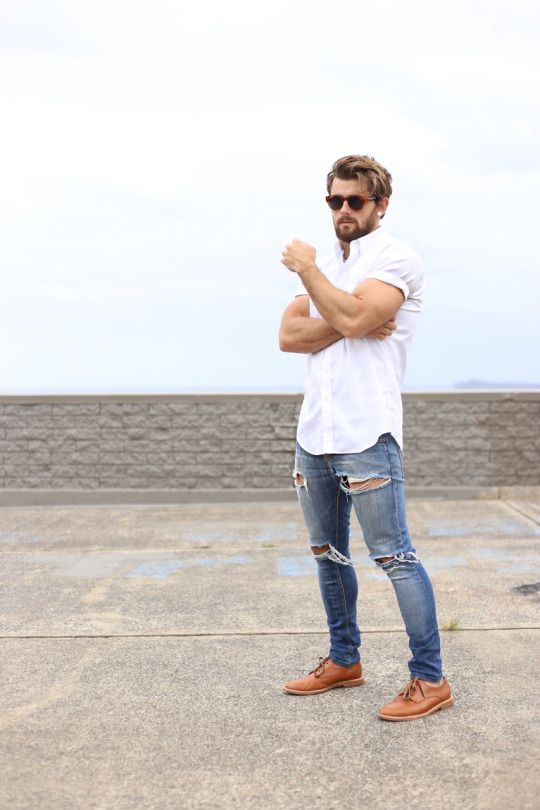 blue ripped jeans, a white shirt, ocher shoes