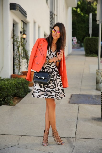 With animal print dress, crossbody bag and heels