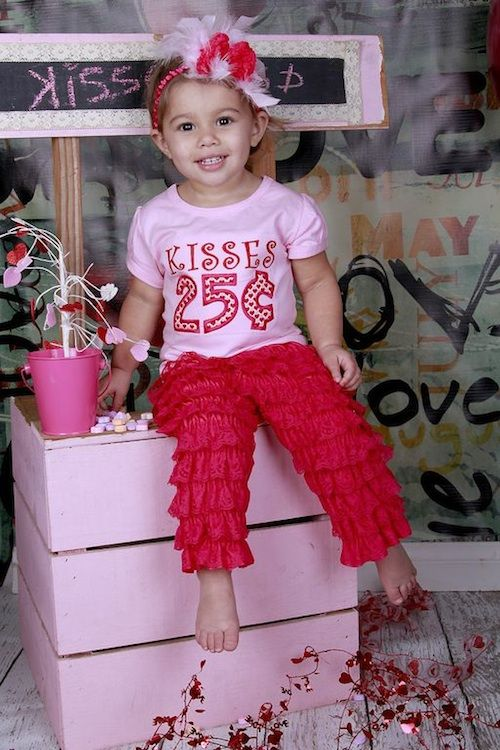 hot red ruffle pants, a pink printed tee and a headpiece