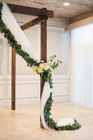 Wedding ceremony alter with drapery and greenery | Starfish Studios