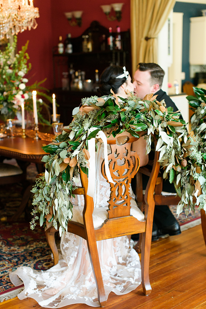 The couple's chairs were decorated with leaves in a lush and bold way