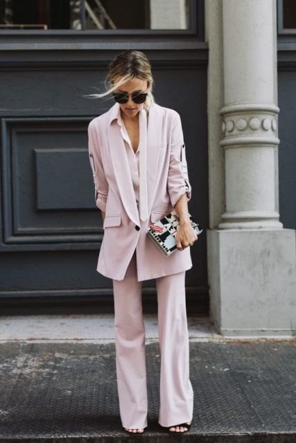 With pale pink long blazer and clutch