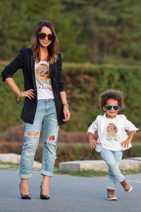 ripped jeans, printed Vogue tees, black shoes and a jacket for the mom, sneakers and a white jacket for the girl