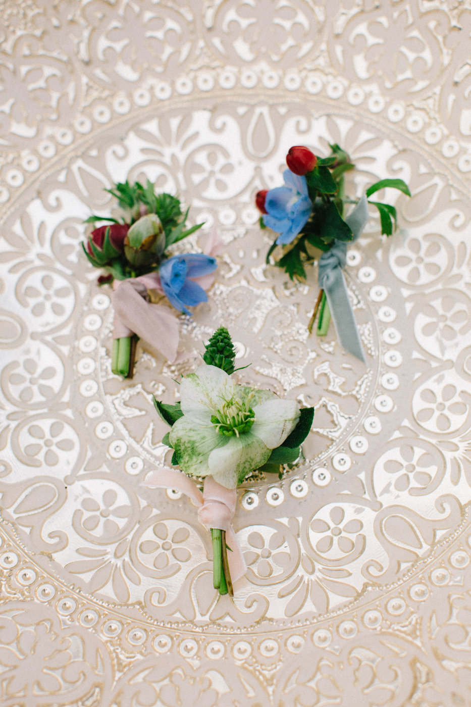 wedding boutonnieres with blue accents - photo by 4 Corners Photography http://ruffledblog.com/backyard-elopement-inspiration-for-valentines-day