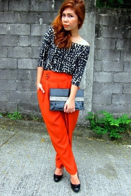 With printed blouse, black shoes and clutch