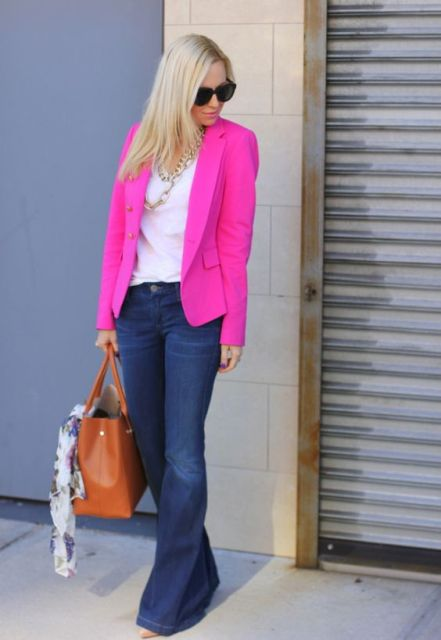 With white shirt, flare jeans and brown tote