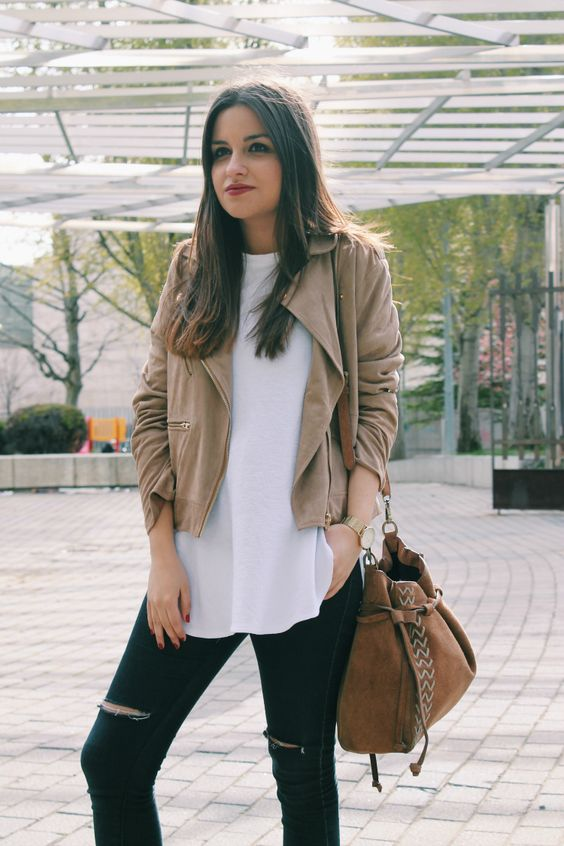 a beige suede jacket, a white tee, ripped jeans and a suede bag