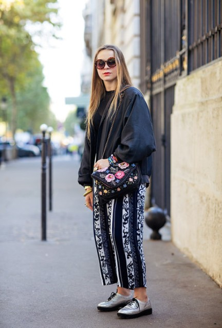 With silver shoes, printed bag and loose jacket
