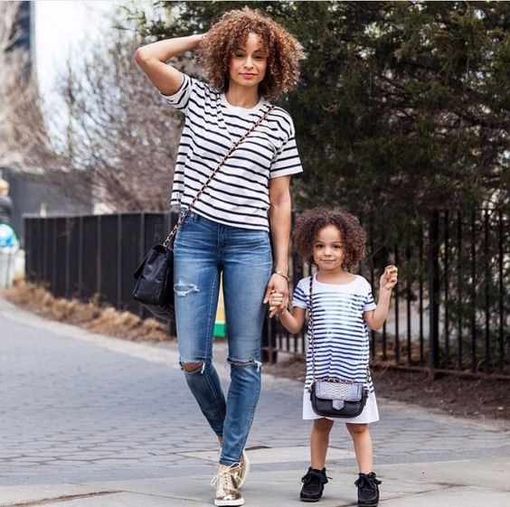 ripped jeans, a striped tee and sneakers for the mom, a striped dress and suede shoes for the daughter