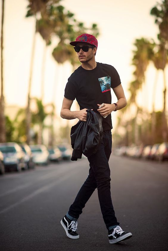 a printed tee, black denim and Vans