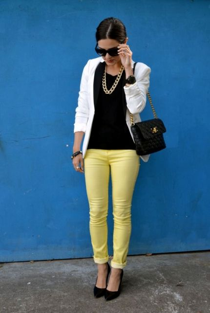 With black blouse, white jacket, chain strap bag and pumps