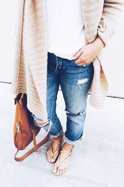 ripped blue jeans, a white tee, a neutral cardigan and sandals