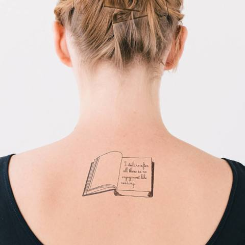 Book tattoo on the back