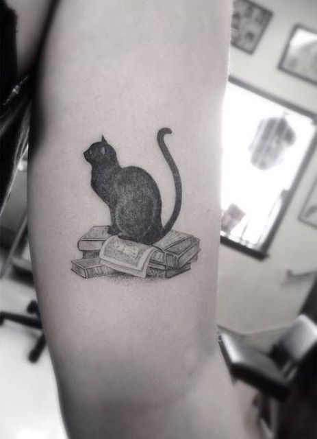 Books and cat tattoo idea