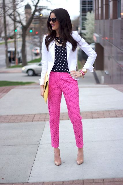 Fuchsia pants with polka dot shirt, white blazer and yellow clutch is an interesting alternative to monochrome office looks.