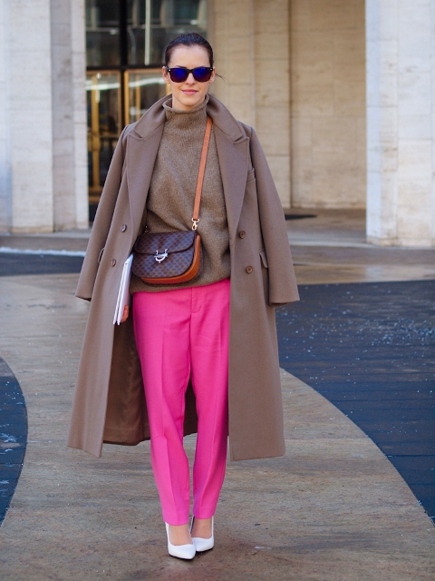 With coat, white shoes and small bag