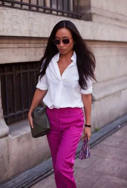 With white shirt, black clutch and sunglasses
