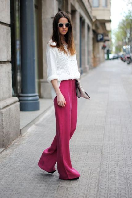 With white sweater and clutch