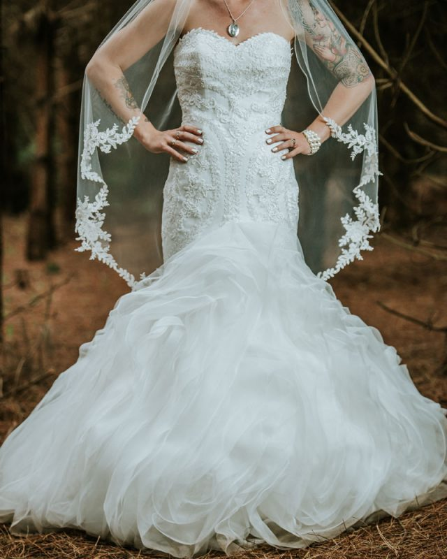 The bride was wearing a gorgeous strapless wedding dress with beading and a mermaid silhouette