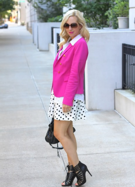 With white shirt, polka dot skirt and black ankle boots