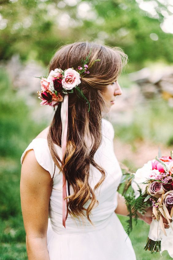 curly half updo with fresh flowers and ribbon