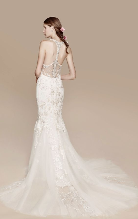 lace mermaid wedding dress with a train and a sparkling bead racerback