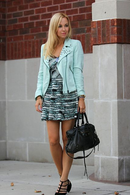 With printed mini dress, black shoes and bag