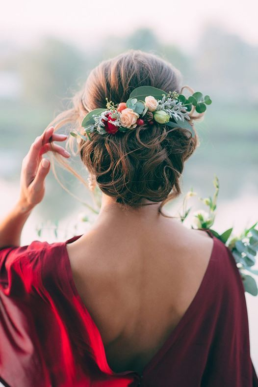 chic curly updo with fresh greenery and flowers