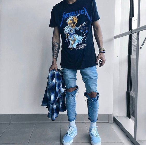 distressed denim, a printed t-shirt and blue Vans