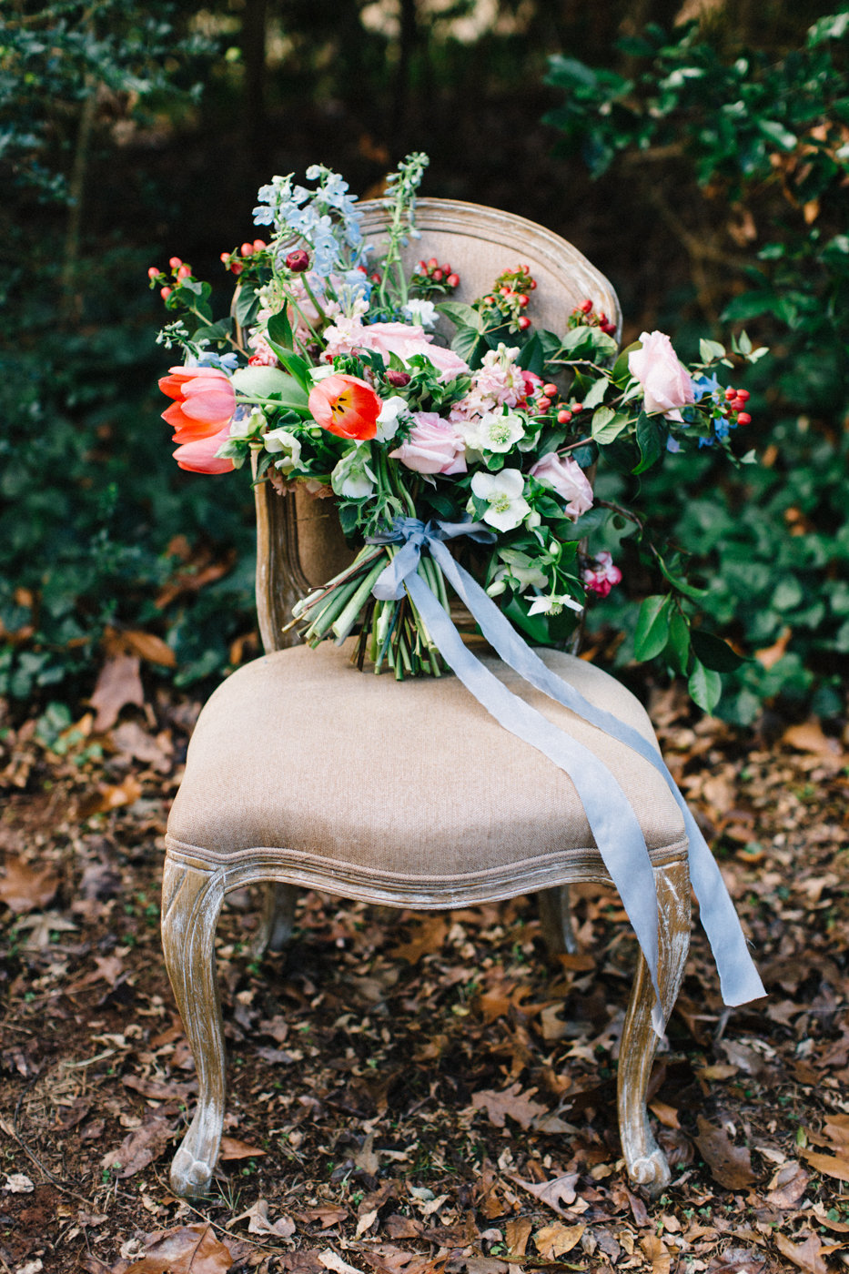 romantic bouquets with blue silk - photo by 4 Corners Photography http://ruffledblog.com/backyard-elopement-inspiration-for-valentines-day