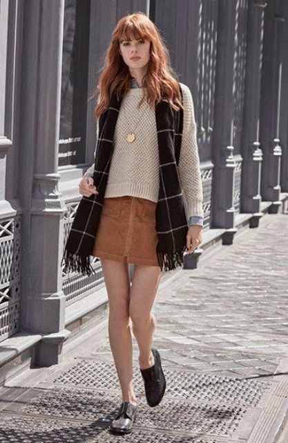 With neutral color sweater, plaid scarf and flat shoes