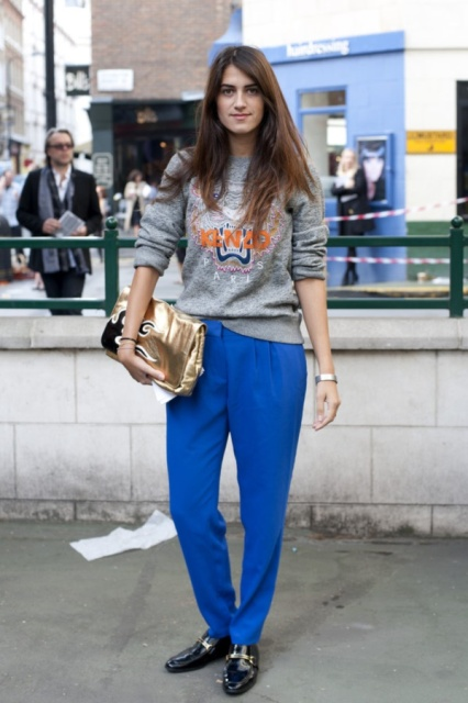 With printed sweatshirt, black loafers and metallic clutch