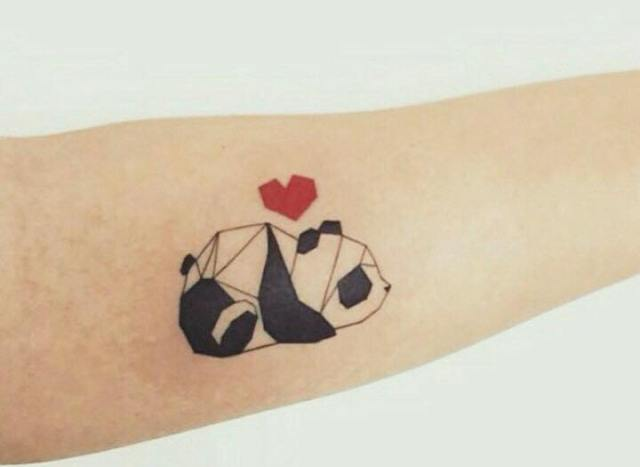 Abstract panda tattoo