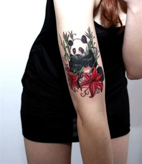 Colored panda tattoo on the arm