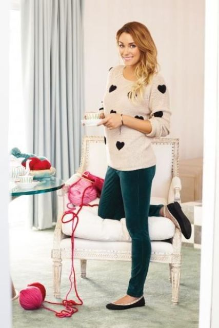 emerald velvet pants, a blush sweater with a black heart print and flats