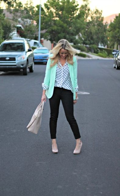 With polka dot blouse, black trousers, neutral shoes and bag