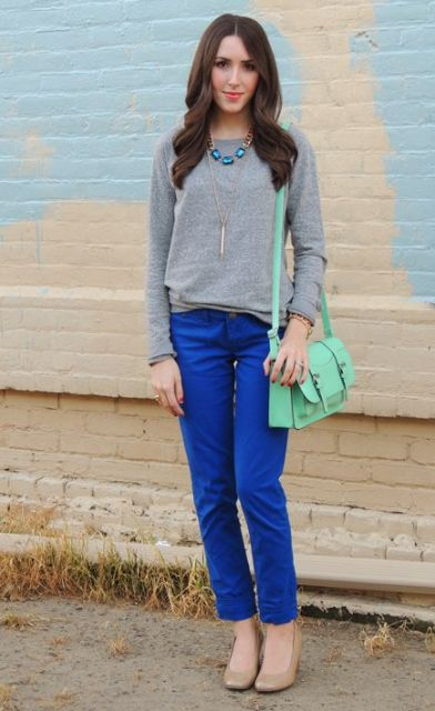 With gray sweatshirt, beige shoes and mint green bag