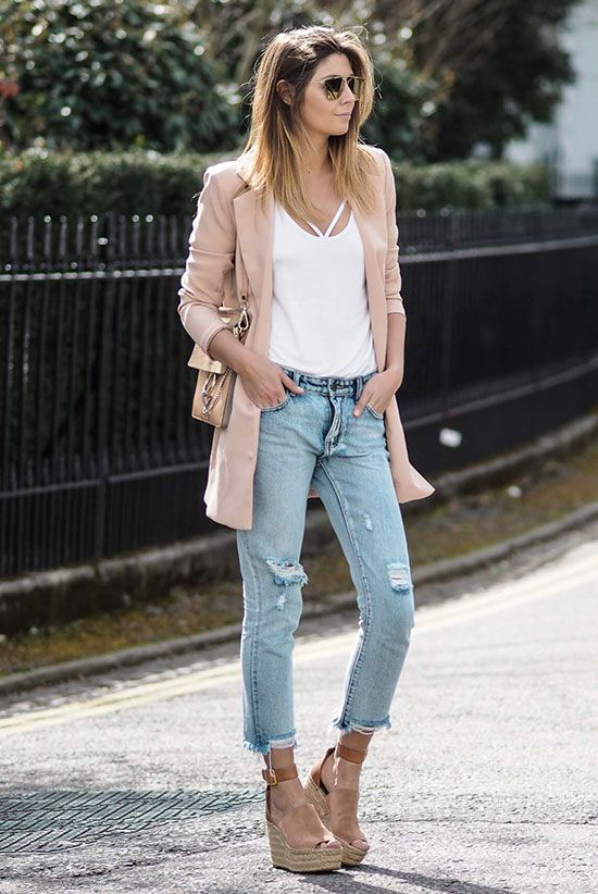 ripped skinnies, a white top, neutral wedges and a blush jacket