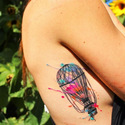 Colorful air balloon tattoo on the side
