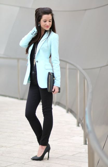 With black shirt and jeans, heels and clutch